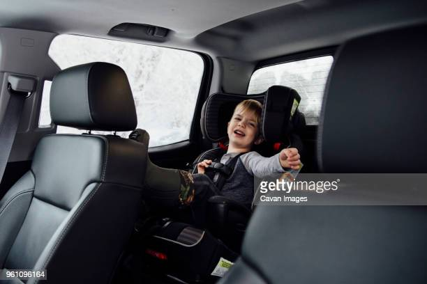 Portrait of boy crying while sitting on vehicle seat