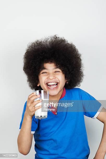 Portrait of boy drinking a glass of milk