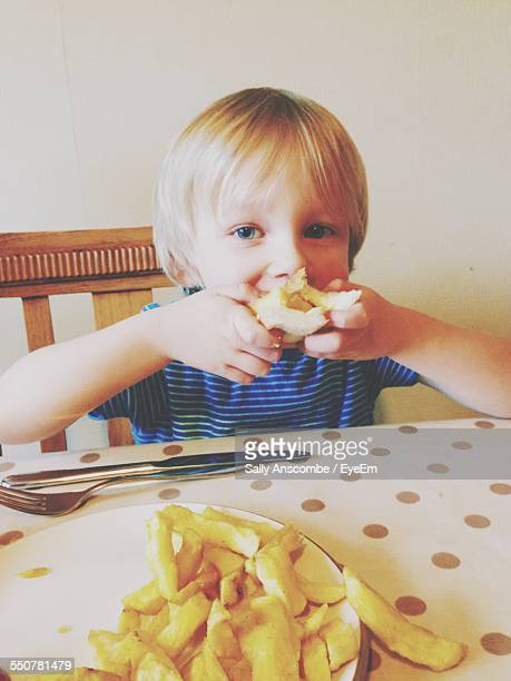 Portrait Of Boy Eating Chip Butty