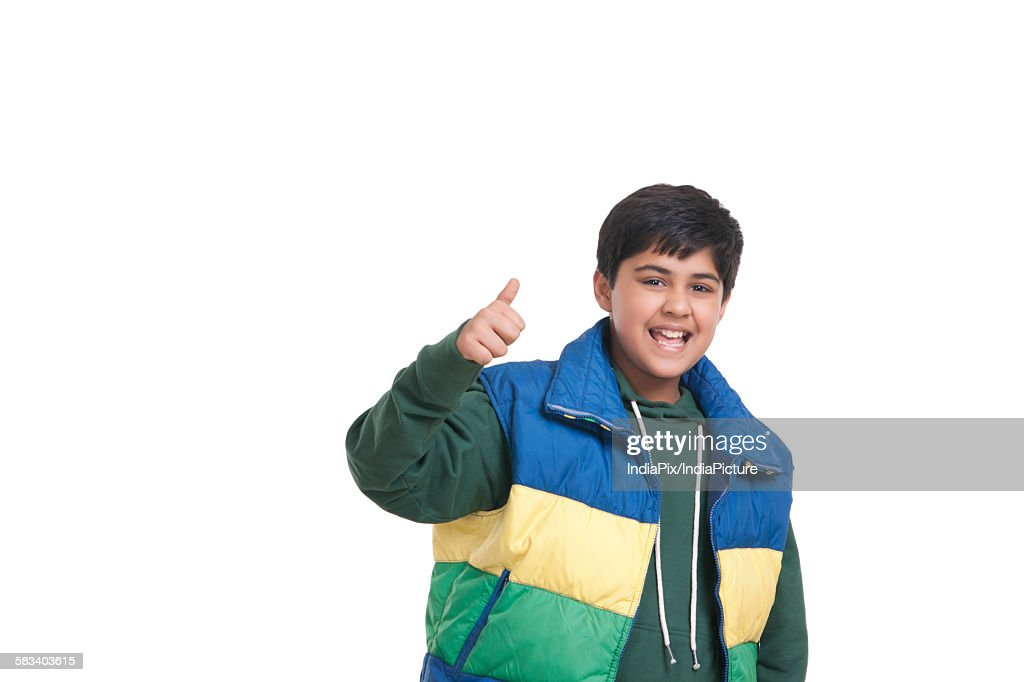 Portrait of boy giving thumbs up : Stock Photo