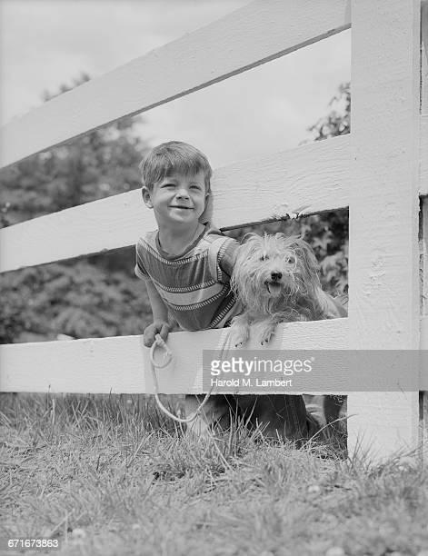 portrait of boy holding dog lead  - mamífero con garras fotografías e imágenes de stock