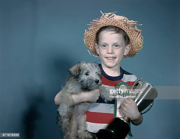 portrait of boy holding puppy and trophy  - {{relatedsearchurl(carousel.phrase)}} stock pictures, royalty-free photos & images