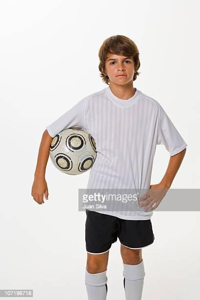 portrait of boy holding soccer ball - axila fotografías e imágenes de stock