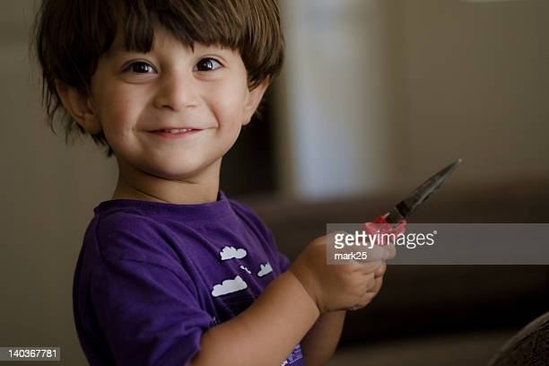portrait of boy holding tong tool - cute pakistani boys stock photos and pictures