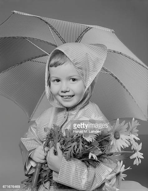 portrait of boy holding umbrella and flowers - {{relatedsearchurl(carousel.phrase)}} stock pictures, royalty-free photos & images