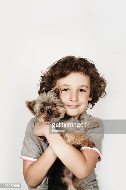 portrait of boy hugging his pet dog - un animal fotografías e imágenes de stock