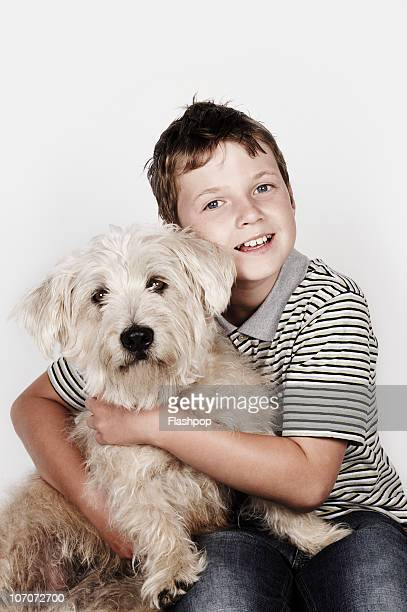 Portrait of boy hugging his pet dog