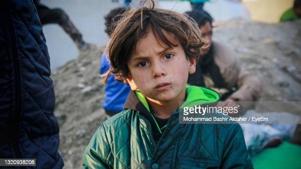 portrait of boy in city - war and conflict stock pictures, royalty-free photos & images