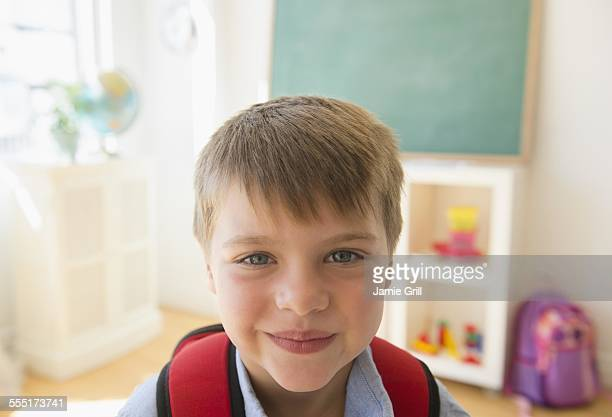 Portrait of boy (6-7) in classroom