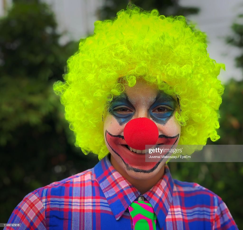 Portrait Of Boy In Clown Costume And Face Paint : Stock Photo
