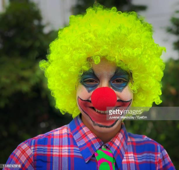 Portrait Of Boy In Clown Costume And Face Paint