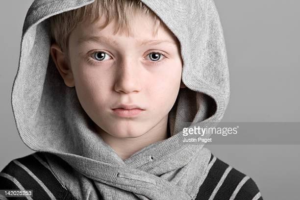 Portrait of boy (7-9) in hooded top