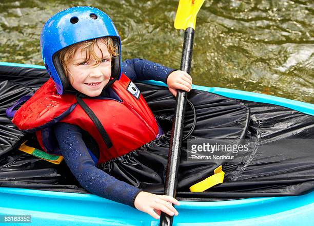 Portrait of boy in kayak.