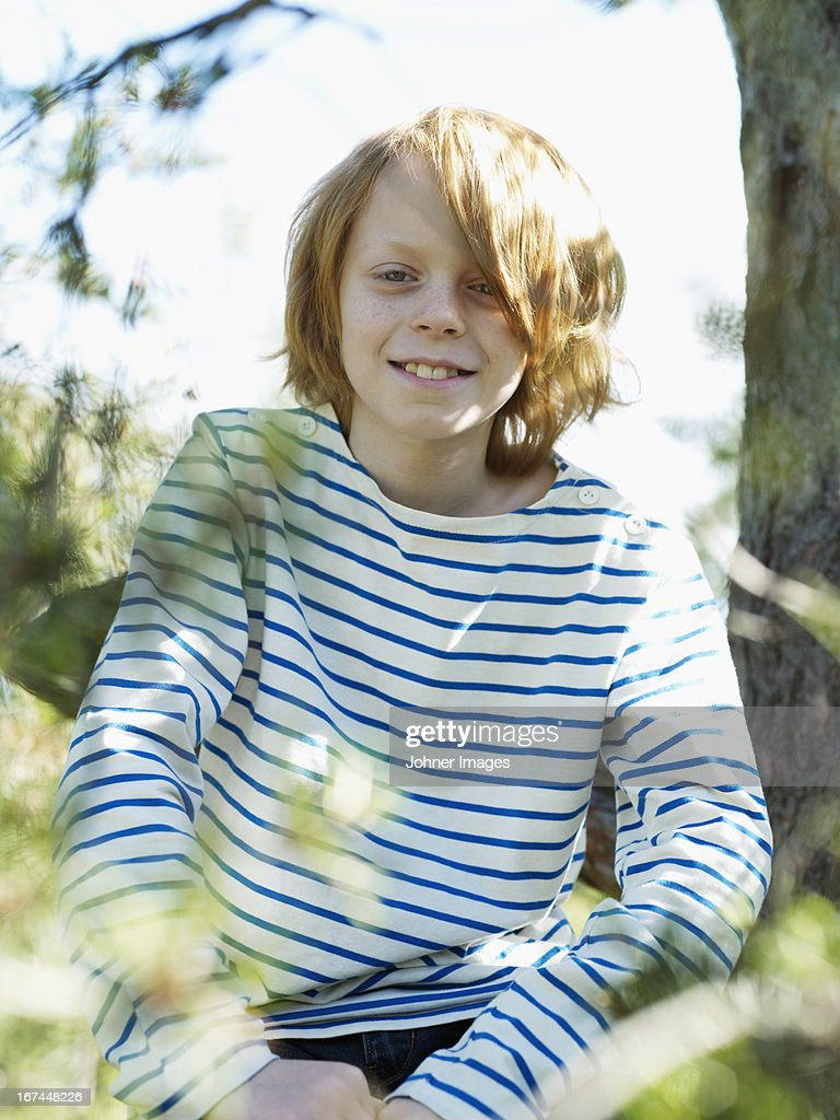 Portrait of boy in park : Stock Photo