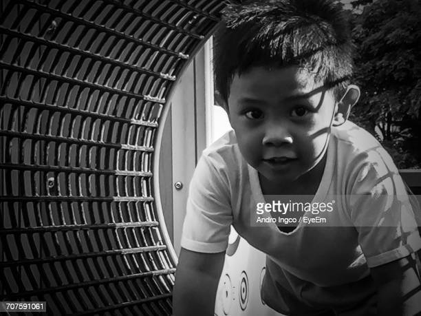 Portrait Of Boy In Play Equipment At Park