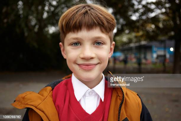 portrait of boy in school uniform - schoolboy stock pictures, royalty-free photos & images