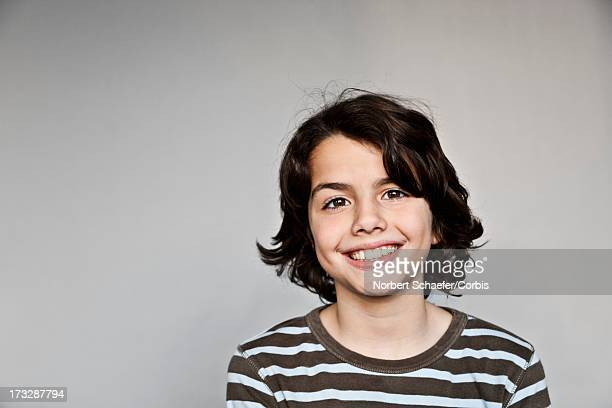 Portrait of boy (10-12) in striped shirt
