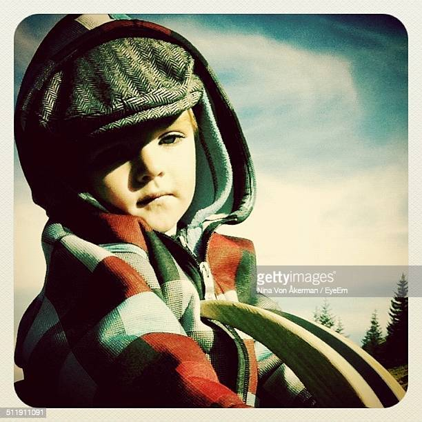 portrait of boy in warm clothing - flat cap stock pictures, royalty-free photos & images