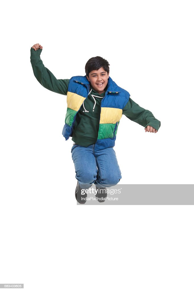 Portrait of boy jumping in the air : Stock Photo