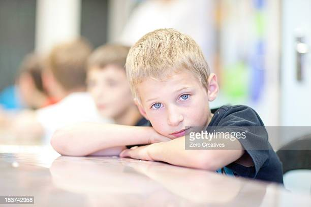 Portrait of boy leaning on elbows