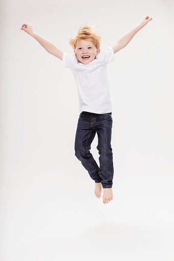 Portrait of boy leaping in air - gettyimageskorea