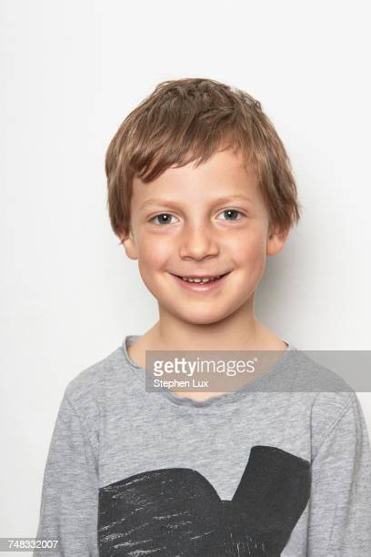 Portrait of boy looking at camera smiling