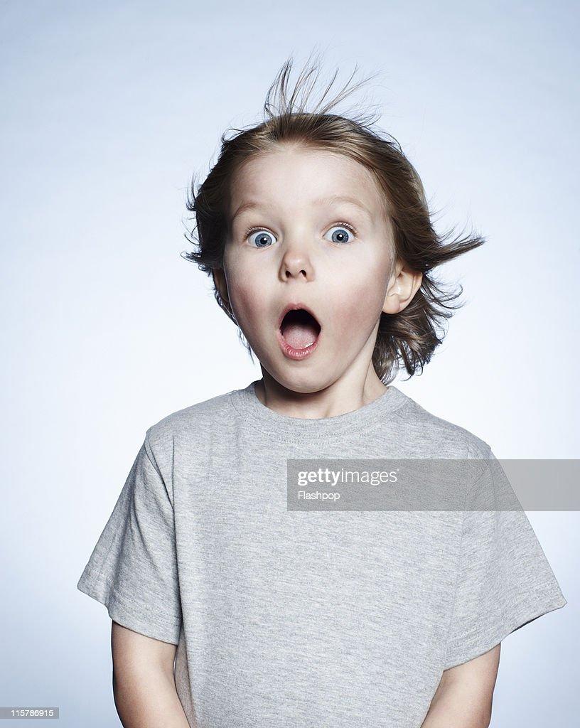Portrait of boy looking surprised : ストックフォト