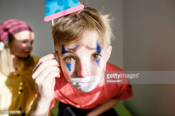 portrait of boy made up as a clown - clown stock-fotos und bilder