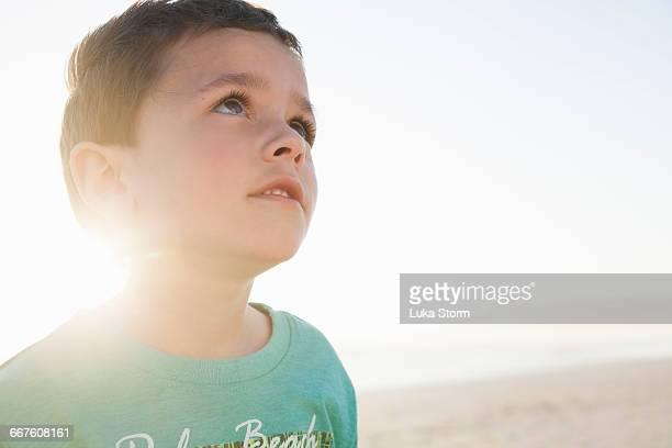 Portrait of boy on beach looking away