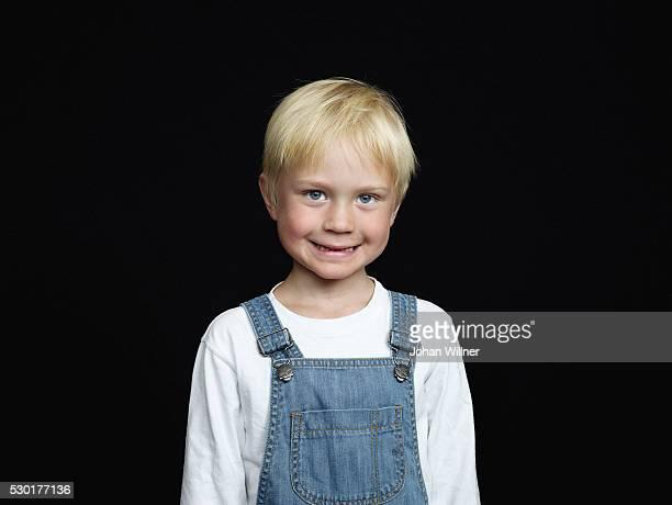 Portrait of boy on black background