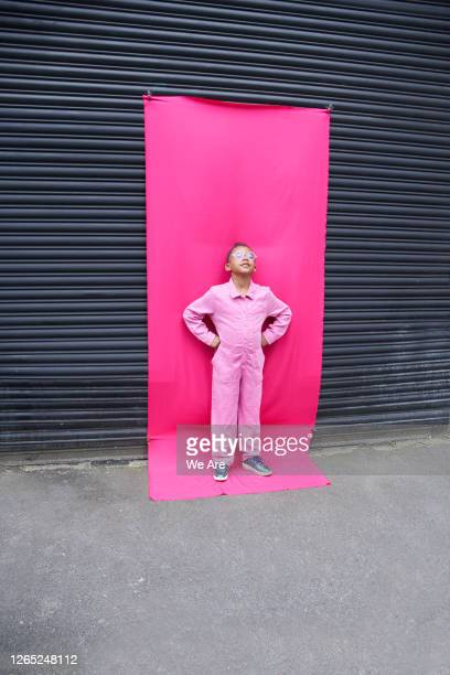 portrait of boy on pink background - one boy only stock pictures, royalty-free photos & images