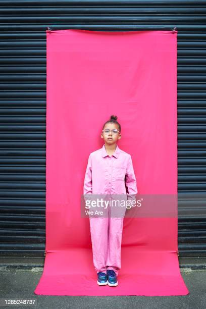 portrait of boy on pink background - hands in pockets stock pictures, royalty-free photos & images