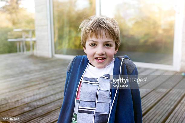 Portrait of boy outside his home.