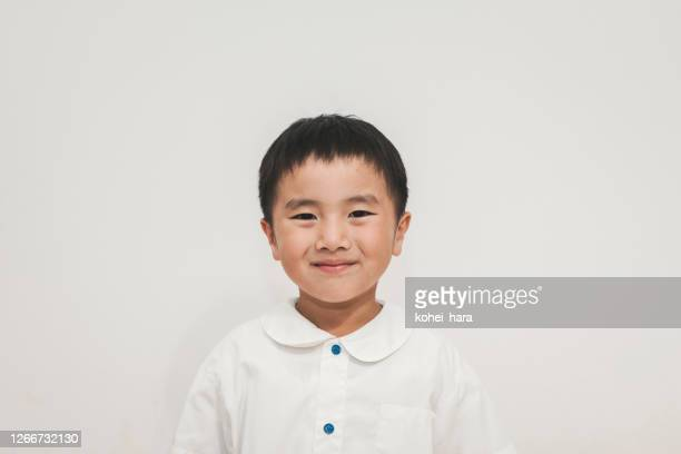 portrait of boy - white shirt stock pictures, royalty-free photos & images