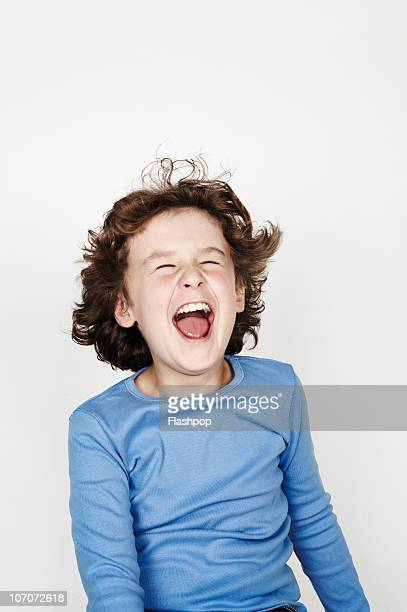 portrait of boy pulling a funny face - only boys stock pictures, royalty-free photos & images