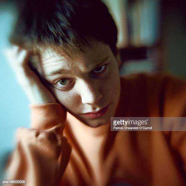 Portrait of boy resting head on hand