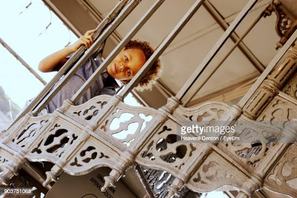 Portrait Of Boy Seen Through Railing