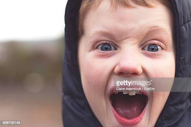 portrait of boy shouting - inverness scotland stock pictures, royalty-free photos & images