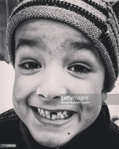 Portrait Of Boy Showing Gap Toothed