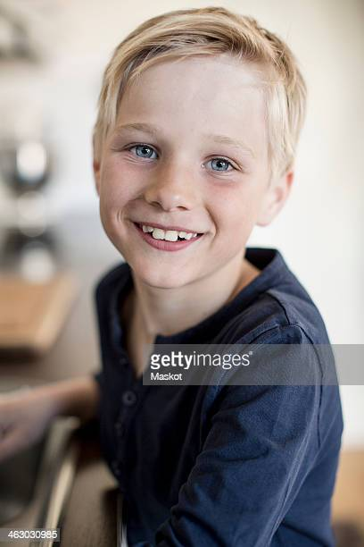 Portrait of boy smiling in kitchen