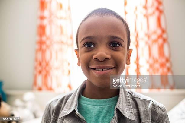 Portrait of boy (8yrs) smiling