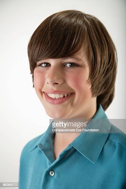 portrait of boy smiling - ピンクの頬 ストックフォトと画像