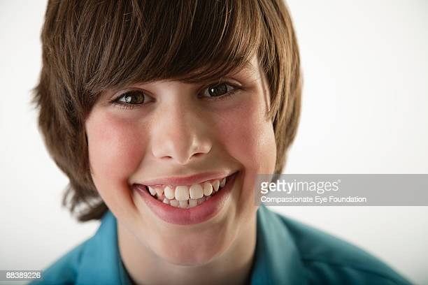 """portrait of boy smiling - """"compassionate eye"""" stock pictures, royalty-free photos & images"""