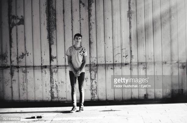 portrait of boy standing against wall - fedor stock pictures, royalty-free photos & images
