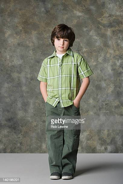 portrait of boy (6-7), studio shot - hands in pockets stock pictures, royalty-free photos & images