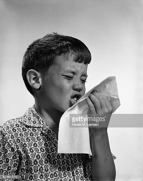 portrait of boy suffering from cold and flu - {{relatedsearchurl(carousel.phrase)}} ストックフォトと画像
