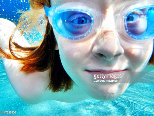 portrait of boy swimming underwater - catherine macbride stockfoto's en -beelden