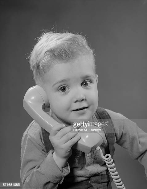portrait of boy talking on telephone - number of people stock pictures, royalty-free photos & images