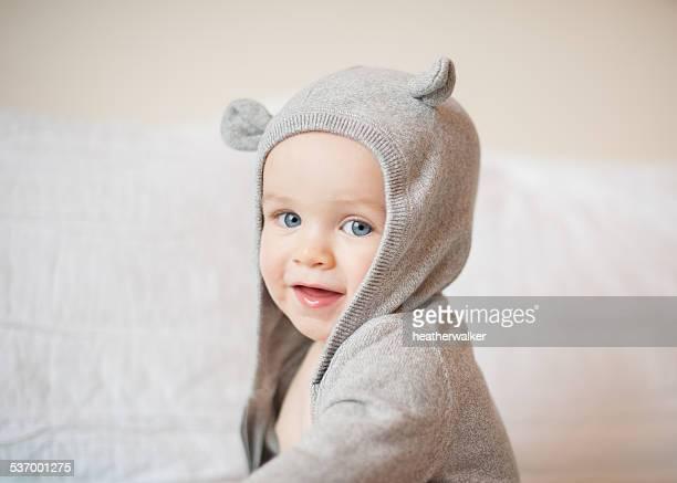 portrait of boy wearing a hooded top - männliches baby stock-fotos und bilder