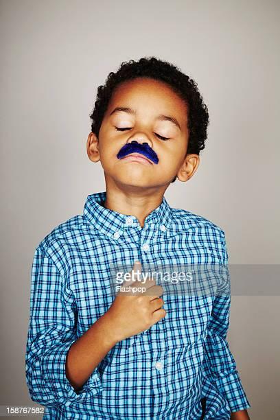Portrait of boy wearing a moustache